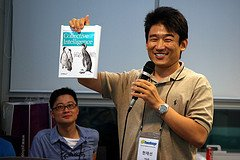 Jaesun Han showing off the collective intelligence book