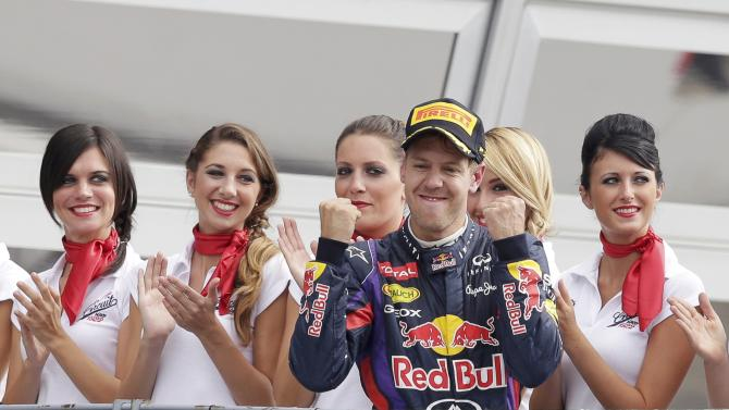 Red Bull Formula One driver Sebastian Vettel of Germany celebrates winning the Italian F1 Grand Prix at the Monza circuit