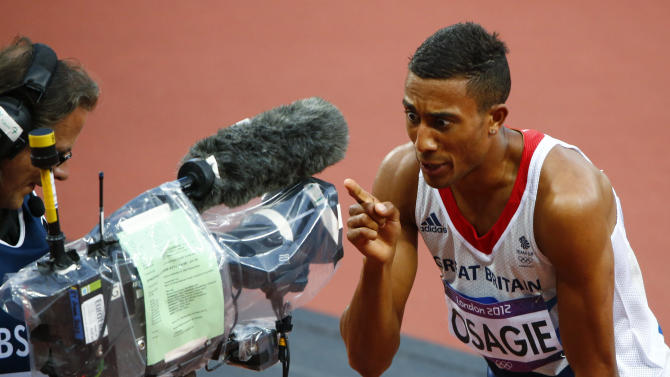 Britain's Andrew Osagie reacts in front of a television camera after his second place finish in his men's 800m semi-final during the London 2012 Olympic Games at the Olympic Stadium