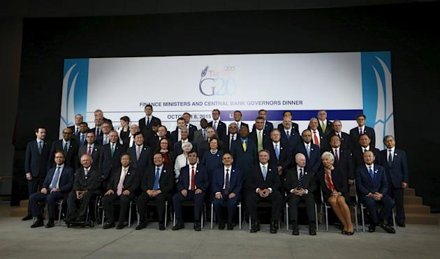 Finance Ministers and head of national banks members of the G-20 pose with IMF Managing Director Lagarde, World Bank President Jim and global policymakers for a group picture at the 2015 IMF/World Ban