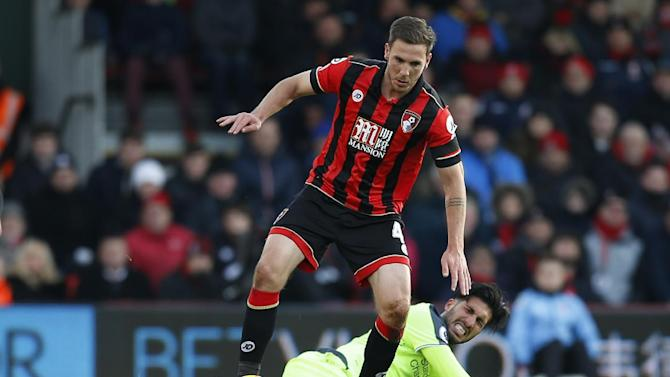 Bournemouth's Dan Gosling in action with Liverpool's Emre Can