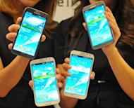 Malaysian police have arrested 12 people over the theft of 1,400 Samsung Galaxy Note II smartphones a day after the device's much-anticipated launch in the country, a police official said Tuesday