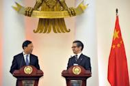 "Indonesian Foreign Minister Marty Natalegawa (R) and his Chinese counterpart Yang Jiechi (L) attend a joint press statement after their meeting at the foreign ministry office in Jakarta. Jiechi said his country was willing to work with Indonesia as an informal mediator to ""maintain peace and stability"" in the South China Sea, amid tensions with neighbouring nations over rival claims to the area"