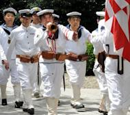 War veterans and others wearing uniforms of the Imperial Navy march at the Yasukuni shrine to honour the dead on the 67th anniversary of Japan's surrender from World War II in Tokyo on August 15, 2012