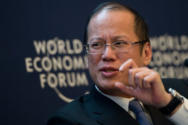 Philippine President Benigno Aquino attends a session of the World Economic Forum at the Swiss resort of Davos, on January 25, 2013. Aquino has welcomed the US Navy's apology for a minesweeper that went aground on a World Heritage-listed coral reef, but said they would not be exempt from penalties