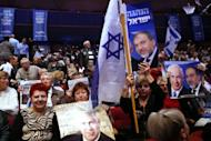 Supporters hold posters of Israeli Prime Minister Benjamin Netanyahu (L) and Foreign Minister Avigdor Lieberman during the launch of the Likud-Beitenu elections campaign on December 25, 2012 in Jerusalem.