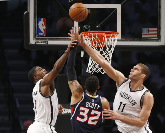 Brooklyn Nets forward Joe Johnson and Nets center Brook Lopez (11) block a shot by Atlanta Hawks forward Mike Scott (32) in the second quarter of Game 4 of a first round NBA playoff basketball game, M