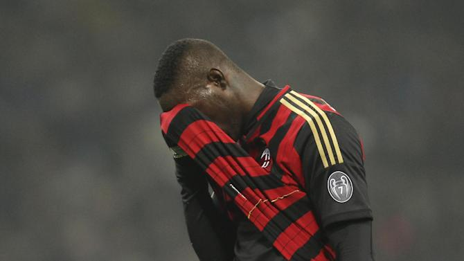 AC Milan forward Mario Balotelli reacts after missing a scoring chance during the Serie A soccer match between Inter Milan and AC Milan at the San Siro stadium in Milan, Italy, Sunday, Dec. 22, 2013. A late goal from Rodrigo Palacio gave Inter Milan a 1-0 win over city rival AC Milan in an entertaining derby match in Serie A on Sunday. Palacio struck four minutes from time to send three quarters of San Siro into a frenzy
