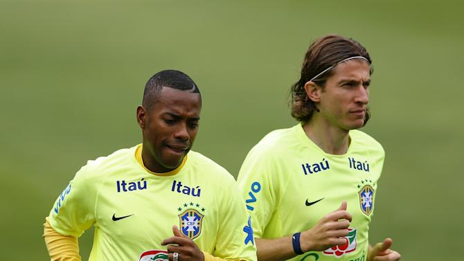 Brazilian national soccer team players Robinho and Luis attend a training session in Teresopolis