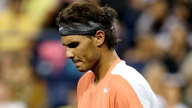 Tennis - Nadal ousted early, Murray and Federer progress at Indian Wells