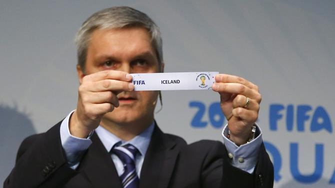 Savic head of FIFA World Cup Qualifiers displays name of Iceland during draw for 2014 World Cup European qualifying playoffs in Zurich