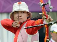 Cheng Ming of China prepares to shoot the arrow during the ranking round of the women's archery individual event at the Lord's Cricket Ground in London
