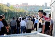 Turkish soldiers under pre-trial detention arrive at court in Silivri, near Istanbul, on September 20. The court is poised to hand down the first verdicts in the trial of hundreds of military officers accused of plotting to overthrow the Islamic-rooted government
