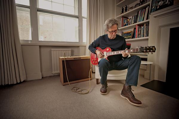 Eric Clapton playing 'Lucy' at home in London. Courtesy of Guitar Center