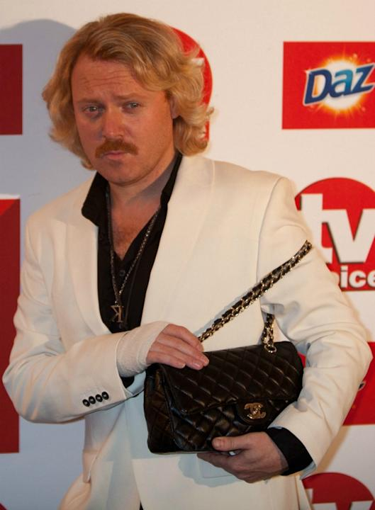 TV presenter Keith Lemon borrowed Holly Willoughby's handbag on the red carpet at the TV Choice Awards. To be fair, we'd have pinched it too.