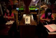 Staff members are seen at a singles club in Beijing. A 2010 survey showed that there were 180 million single men and women in China -- out of a population of 1.3 billion people -- and that 92 percent of men questioned believed that a woman should be married before the age of 27