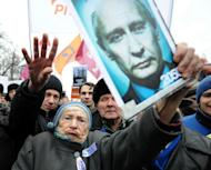 A file picture taken on December 10, 2011, shows opposition activists protesting against alleged mass fraud in the December 4 parliamentary polls in central Moscow. Russian President Vladimir Putin marked a year since his election to a third term on Monday riding a tide of popularity despite his crackdown on political freedoms and tense ties with the United States