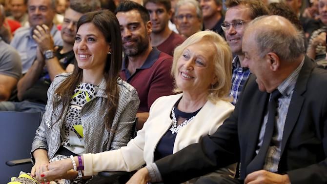 Wife Nuria Cunillera and parents Maria Merce Creus and Joaquin Hernandez smile as Barcelona's Xavi Hernandez announces the pregnancy of his wife during his farewell event at Auditori 1899 in Nou Camp stadium in Barcelona