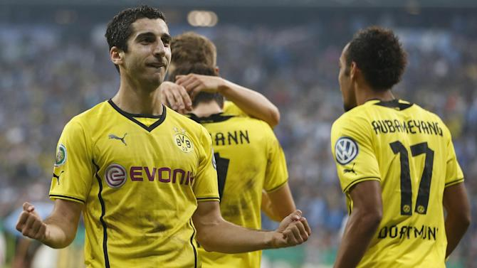 Dortmund's Henrikh Mkhitaryan of Armenia celebrates after scoring his side's second goal during the German soccer cup second round match between TSV 1860 Munich and Borussia Dortmund, in Munich, southern Germany, Tuesday, Sept. 24, 2013