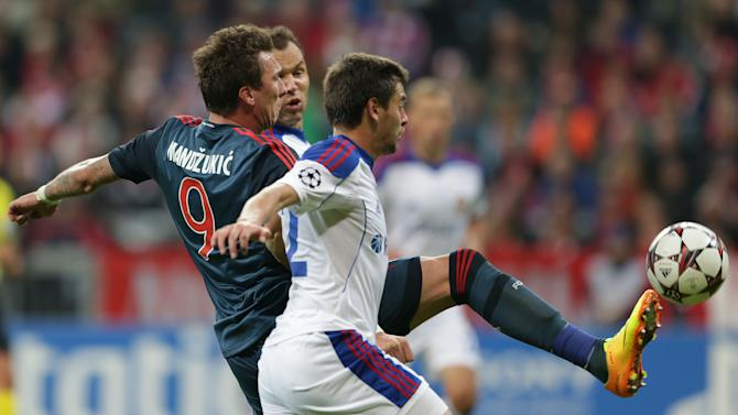 Bayern Munich's  Mario Mandzukic of Croatia, background, and Moscow's Georgi Schennikov, vie for the ball,  during their Champions League first round group D soccer match between FC Bayern Munich and CSKA Moscow, in Munich, Germany, Tuesday, Sept. 17, 2013