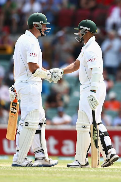 ADELAIDE, AUSTRALIA - NOVEMBER 23:  Graeme Smith and Alviro Petersen of South Africa celebrate their 100 run opening partnership during day two of the Second Test match between Australia and South Afr