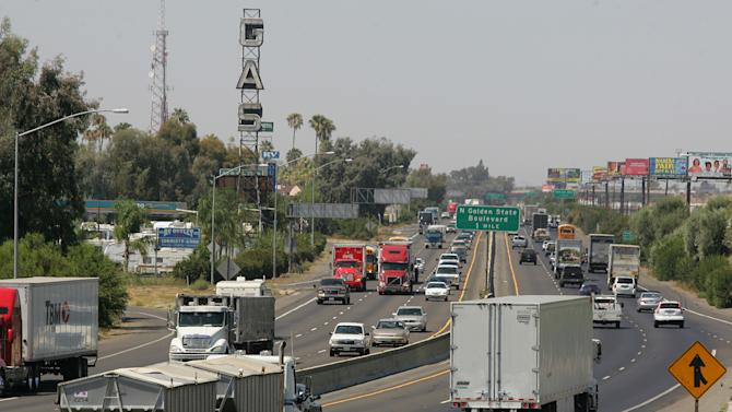 "FILE - In this Aug. 23, 2011 file photo, a stretch of the Calif. State Route 99 corridor in the San Joaquin Valley is shown busy with traffic in Fresno, Calif.  CThe United Nations climate chief is urging people not to look solely to their governments to make tough decisions to slow global warming, and instead to consider their own role in solving the problem. Approaching the half-way point of two-week climate talks in Doha, Christiana Figueres, the head of the U.N.'s climate change secretariat, said Friday, Nov. 30, 2012 that she didn't see ""much public interest, support, for governments to take on more ambitious and more courageous decisions.""(AP Photo/Gary Kazanjian, File)"