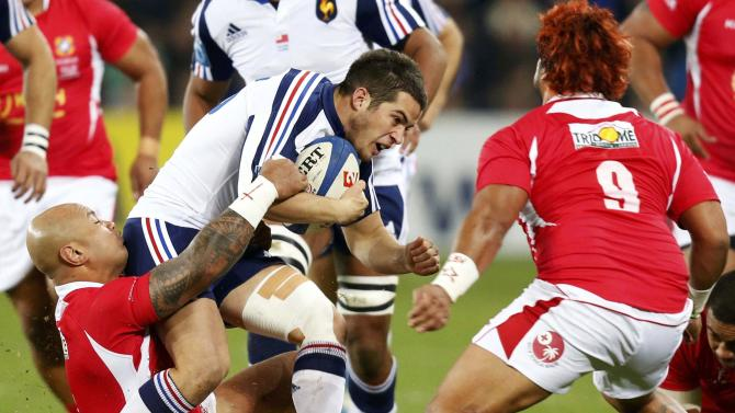 France's Brice Dulin is tackled by Tonga's Nili Langilangi Latu during their rugby union test match in Le Havre