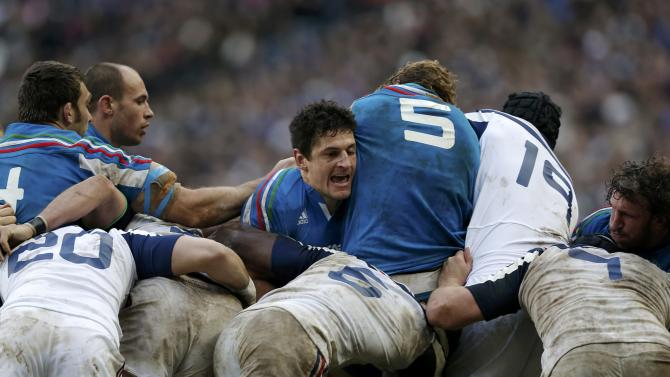 Italy's Alessandro Zanni fights for the ball with teammates during their Six Nations rugby union match against France at the Stade de France in Saint-Denis