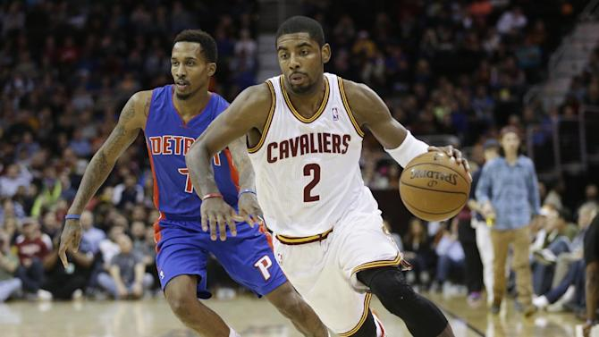 Cleveland Cavaliers' Kyrie Irving (2) drives past Detroit Pistons' Brandon Jennings (7) during the second quarter of an NBA basketball game Monday, Dec. 23, 2013, in Cleveland
