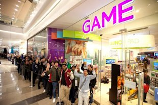 A Tale Of Two Tech Giants: Why You Can't Always Trust The Buzz Alone image Zohair Ali is first in the queue to pick up a copy of Grand Theft Auto V at the GAME store in Westfield London.jpg 600x399