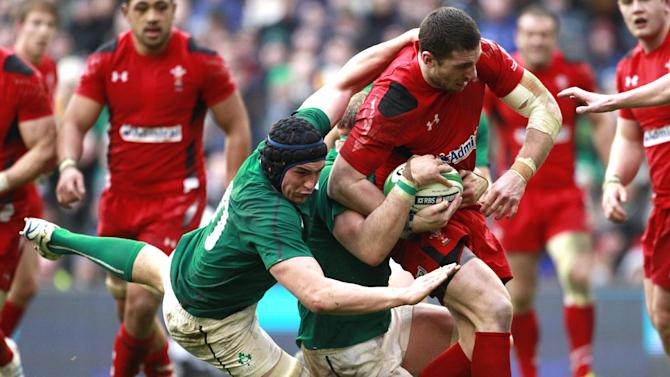 Wales Alex Cuthbert, right is tackled by Ireland's Tommy O'Donnell, left, during their Six Nations Rugby Union international match at the Aviva Stadium, Dublin, Ireland, Saturday, Feb. 8, 2014. (AP Photo/Peter Morrison)