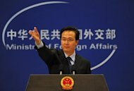 China's foreign ministry spokesman Hong Lei, seen here in 2010, said Beijing is ready to work with France after the election of Socialist Francois Hollande as president, amid concerns his victory could derail Paris's deficit-cutting plan