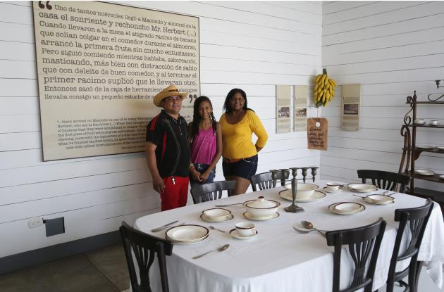 Tourists pose for a photo during their visit at a museum converted from the house Colombian author Gabriel Garcia Marquez grew up in, at Aracataca