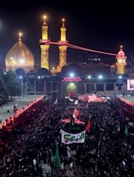 Shiite Muslims gather outside the shrine of Imam Abbas in Karbala early on Sunday. 30,000 security forces personnel have been deployed at the northern, southern and eastern entrances of Karbala to protect the pilgrims.
