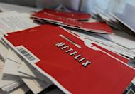 Netflix envelopes sit in a bin with other mail at the U.S. Post Office sort facility in 2011 in San Francisco, California. The US online movie business more than doubled in 2011 to rake in $992 million and will almost double again this year