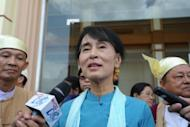 Myanmar opposition leader Aung San Suu Kyi talks to the media as she leave the lower house of parliament in Naypyidaw in July 2012. Suu Kyi held talks with the country's president on Sunday in their first official meeting since she took up her role as a member of parliament