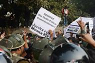 IAnti-rape demonstrators in New Delhi on Thursday. Doctors in Singapore battled Thursday to save the life of an Indian student who sustained horrific injuries in a gang-rape after she was dramatically airlifted from a hospital in New Delhi