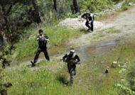 Syrian rebels from the Al-Ezz bin Abdul Salam Brigade take part in a training session at an undisclosed location near Jabal Turkmen in northern Latakia province on April 24, 2013. The UN says the civil war in Syria has left at least 70,000 people dead since March 2011
