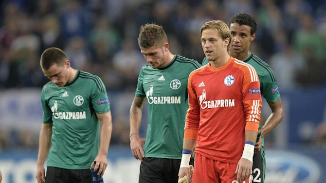 Schalke players; from left,  Christian Clemens, Roman Neustaedter, goalkeeper Timo Hildebrand and Joel Matip leave the pitch after losing 0-3 during the Champions League group E soccer match between FC Schalke 04 and Chelsea FC in Gelsenkirchen, Germany, Tuesday, Oct. 22, 2013