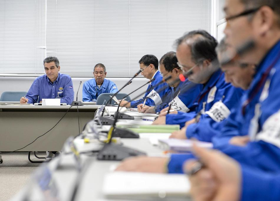 Art Azarbarzin, NASA Global Precipitation Measurement (GPM) project manager, left, participates in the GPM Launch Readiness Review (LRR) along with Chief officers from Mitsubishi Heavy Industries, Ltd