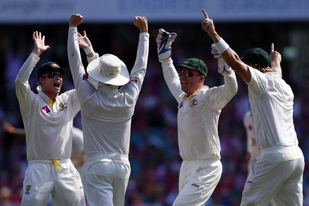 Australia's Smith captain Clarke , Haddin and Watson celebrate after winning the fifth Ashes cricket test against England at the Sydney cricket ground