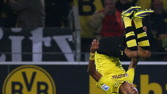 Dortmund's Pierre-Emerick Aubameyang of Gabon celebrates after scoring during the German first division Bundesliga soccer match between  BvB Borussia Dortmund and VfB Stuttgart  in Dortmund, Germany, Friday, Nov. 1, 2013