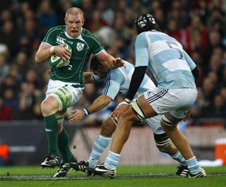 Ireland's Paul O' Connell is challenged by Argentina's Patricio Albacete during their friendly international rugby union match at Croke Park in Dublin