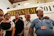 """Members of the Green Party announce the """"yes"""" vote in the non-binding referendum to legalise divorce in Malta at a polling station in Valetta. Overwhelmingly Catholic Malta has voted in favour of legalising divorce, Prime Minister Lawrence Gonzi announced Sunday after a referendum in one of the only two countries where it is still banned"""