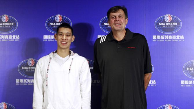 NBA Houston Rockets' player Jeremy Lin and head coach Kevin McHale pose for pictures during a news conference in Taipei