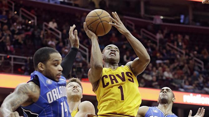 Varejao leads Cavaliers past Magic 87-81 in OT