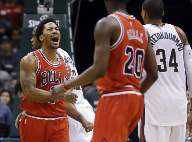 Chicago Bulls' Derrick Rose reacts after scoring during the second overtime of Game 3 of an NBA basketball first-round playoff series against the Milwaukee Bucks on Thursday, April 23, 2015, in Mi