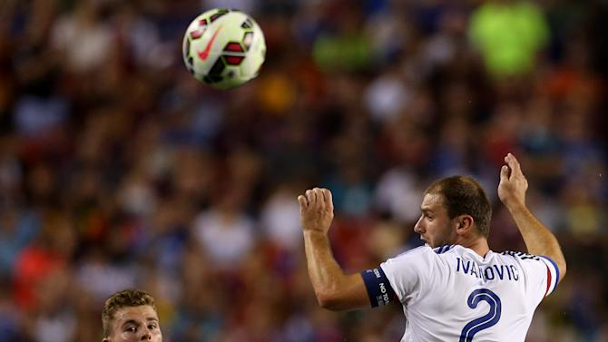 FC Chelsea defender Branislav Ivanovic (2) completes  a header against FC Barcelona defender Jérémy Mathieu (24)on Tuesday,July,28, 2015, in Landover, Maryland. Chelsea and FC Barcelona face off at the 2015 International Champions Cup. Damian Strohmeyer/AP Images for International Champions Cup