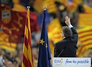 Artur Mas, leader of Spain's Catalonia region, waves at supporters at the end of a final meeting for his re-election campaign. Mas vowed on Friday to fight for the 'future of our nation' before a roaring crowd of supporters, ahead of weekend elections that could lead to a popular demand for statehood.