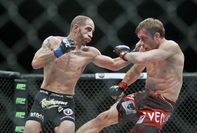 Chico Camus, left, punches Brad Pickett in a flyweight mixed ...
